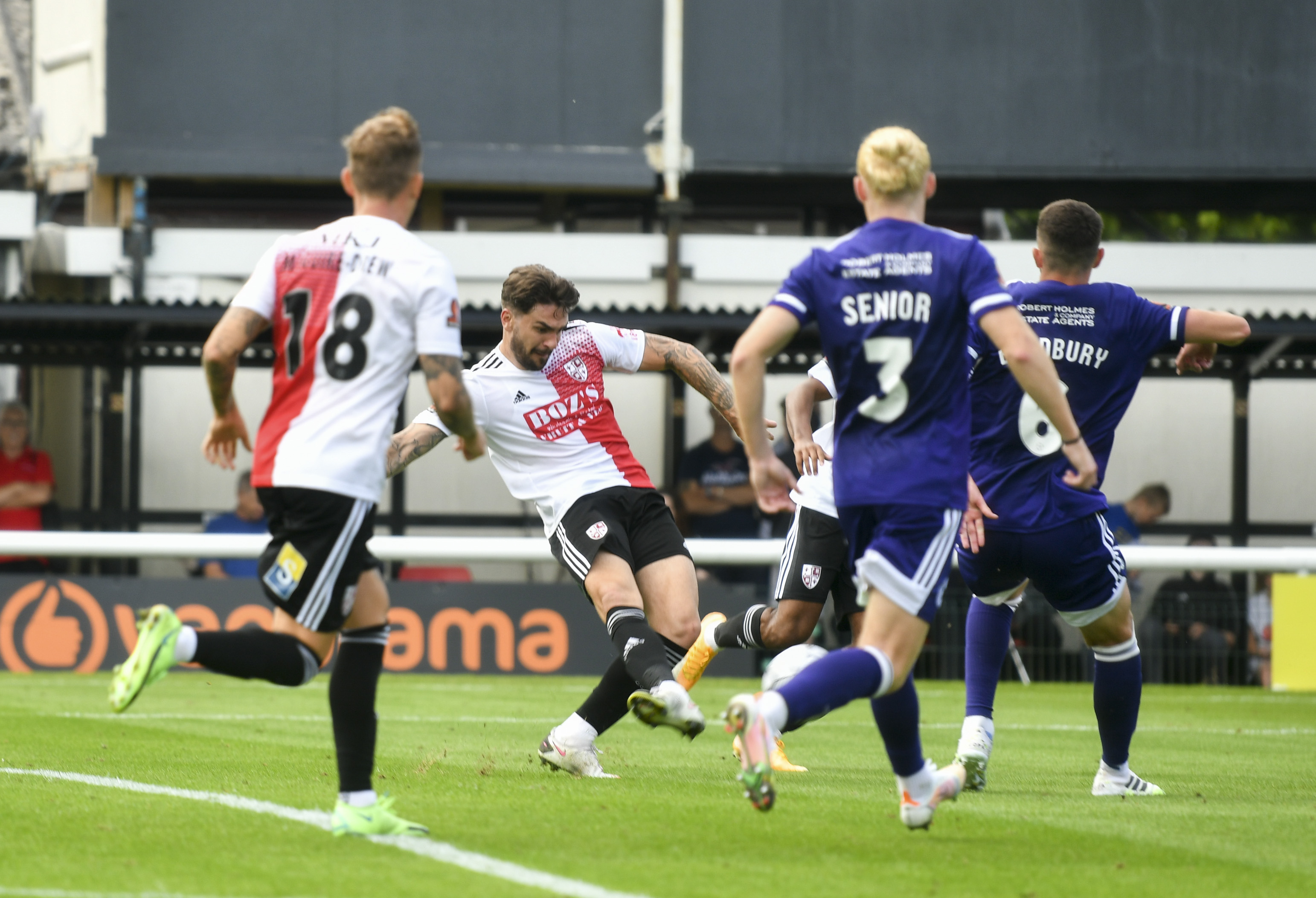 Oakley puts the ball away neatly for Woking's second